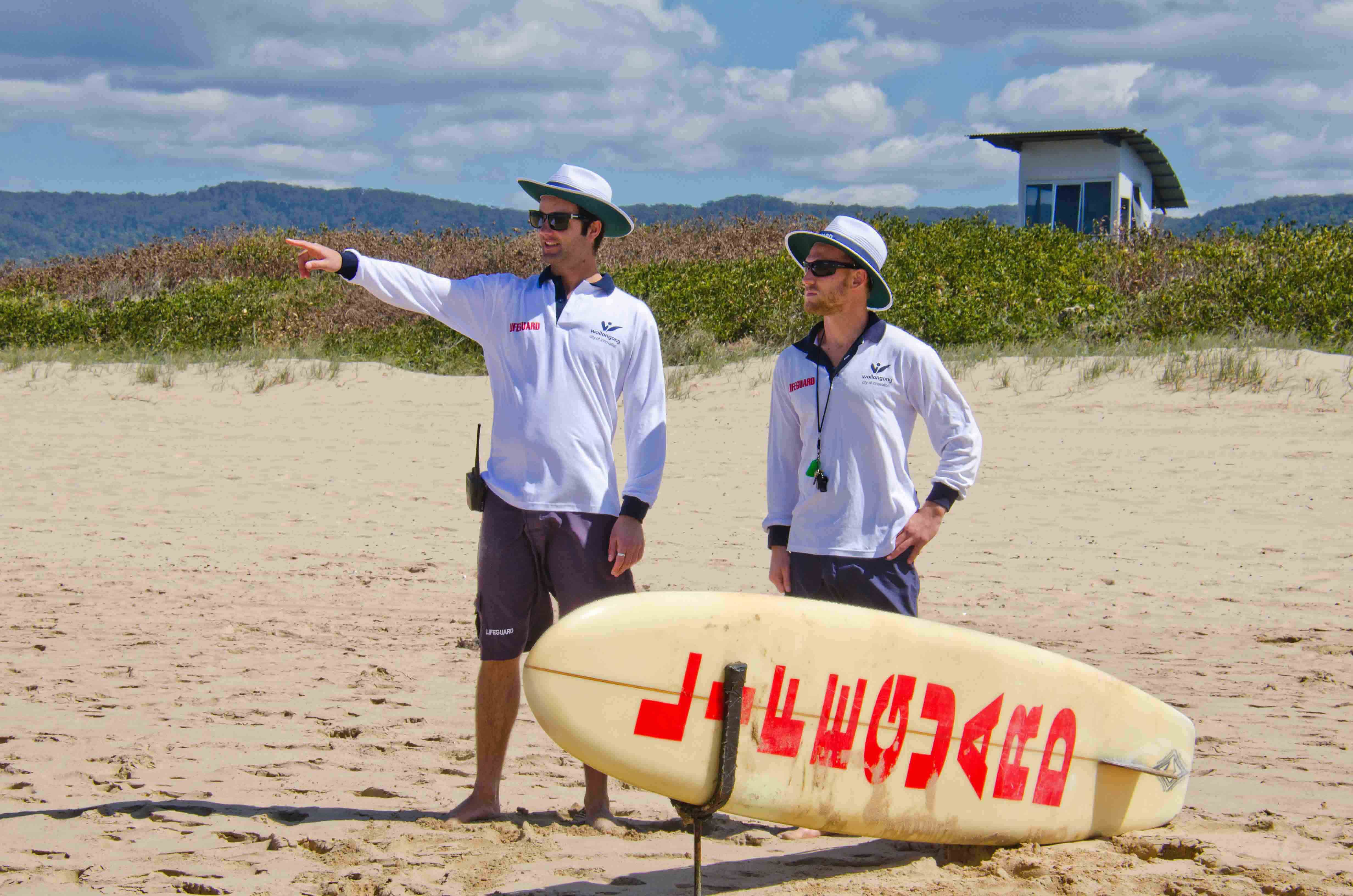 Wollongong Life Guards Peter Hopkins and Ian Logue prepare for the beginning of another surf season at Corrimal Beach today. PHOTO: Warren & Diana Ackary.