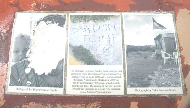 One of the vandalised plaques. The vandals seem to indicate that the plaque should be located at Sandon Point, Bulli, rather than at Collins Point, Woonona.