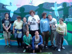 Youth celebrate the completion of the Thirroul mural project.