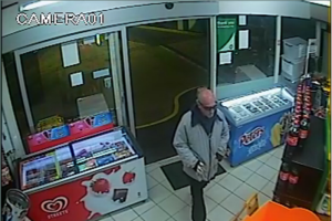 Police have released a CCTV image of a man wanted for the robbery of a Woonona service station on Monday
