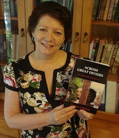 Susan Boyer with her book, Across Great Divides: True Life Stories at Sydney Cove.