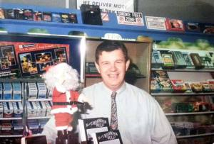 Graham Sturgiss behind the counter of his Woonona Newsagency in the 1990s.