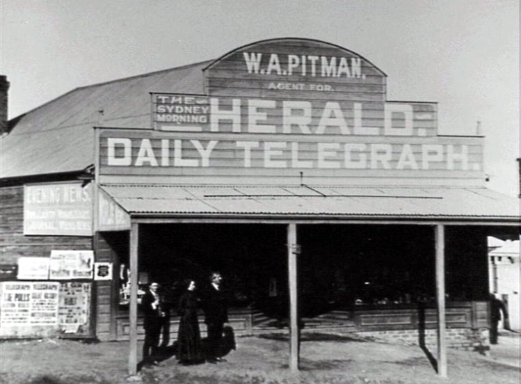 Pitman's Newsagency, Woonona C1918. The shop was built by Henry Pitman who is shown at the left with his wife Rachel and son William Austin.