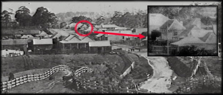"Old Bulli village C1880, showing inset Orvad's Denmark Hotel. A single storey weatherboard and slab dwellings. ""Orvad's""can be seen painted on the side of the building."