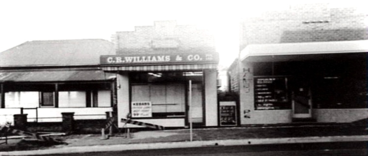 The Bulli butcher shop when John Williams operated it. The dwellings to the left was the original home of the Floyd family. The house was demolished to make way for the current butcher shop in the corner of Park Road and the Princes Highway. The old butcher shop is still in existence.