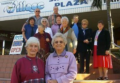 Edith Robinson (left) and Elaine Broadhead with former employees of Hardies Rubber factory.  The site is now the Thirroul Plaza Shopping Plaza in 2003.