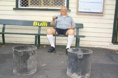 Ken Henson on Bulli Railway Station in 2004, with a couple of old sanitary pans that were disguised as pot plants during the Queens visit 50 years prior.