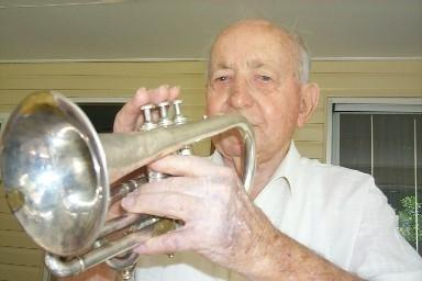 Eighty-five-year-old Doug Davies (in 2005) with the cornet he used in the 1933 Corrimal Town Band.